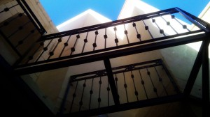 Suspended wrought iron railing with transparent glass flooring  - General Metal Works Malta