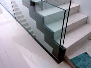 hand railing staircase with thick glass separators  - General Metal Works Malta
