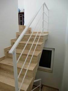 white staircase hand railing  - General Metal Works Malta