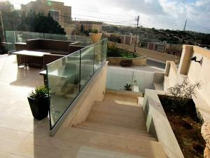 stainless steel hand railing with featured glass - General Metal Works Malta
