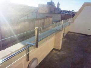 Stainless steel hand railing with glass effect - General Metal Works Malta